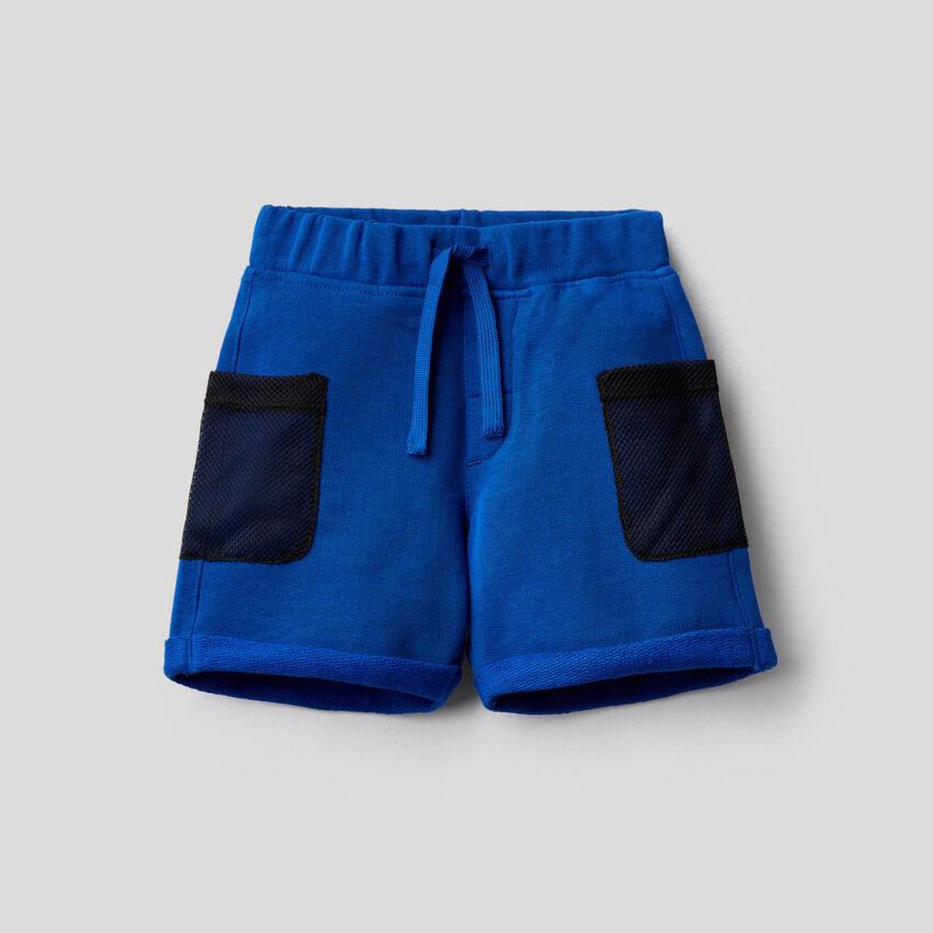 Bermudas de felpa con bolsillos de rejilla