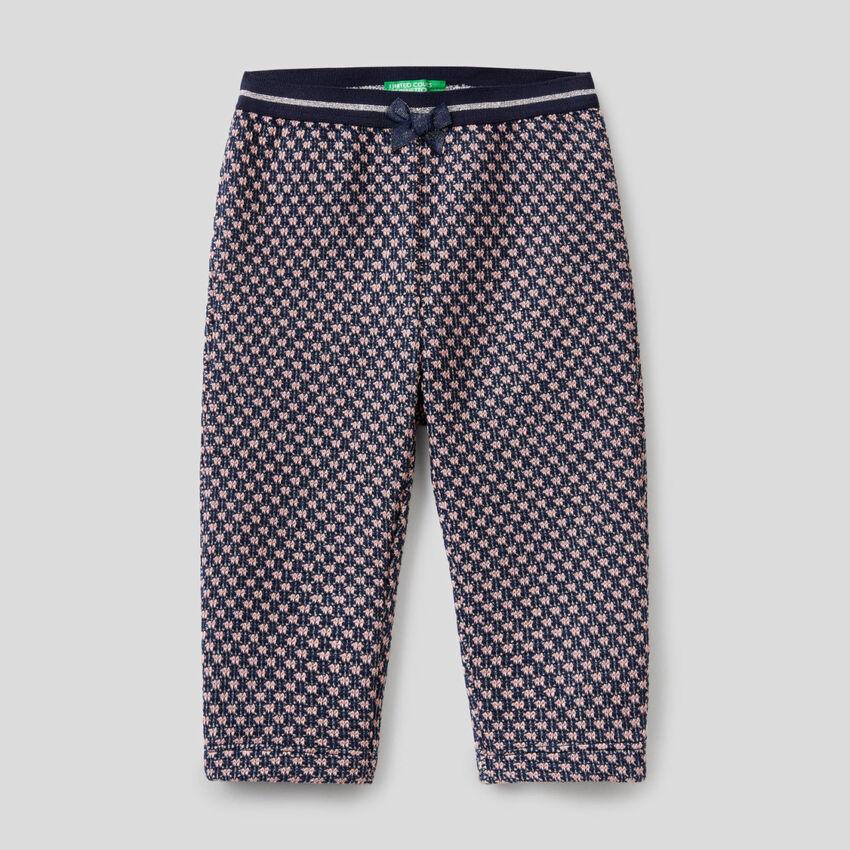 Pantalón con motivo geométrico bicolor