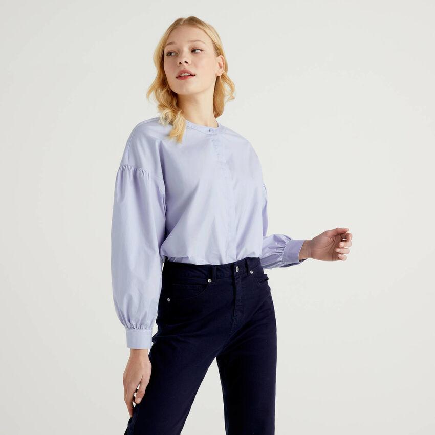 Blusa de algodón elástico con mangas abullonadas