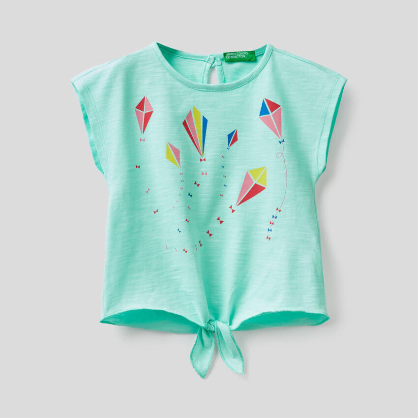 Camiseta de 100% algodón con lazo en el bajo