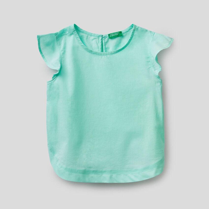 Blusa de algodón con volantes en las mangas